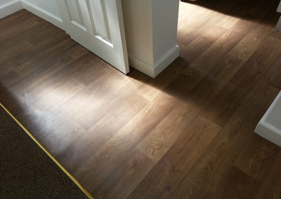 Vinyl flooring with a Laminate Design
