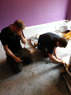 flecked carpet being fitted in a lounge in Wythenshawe
